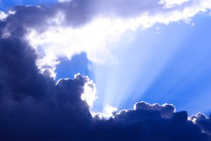 Clouds: Sun rays shining over clouds