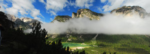 Panorama in Dolomites: Panorama of the valley with two layers of clouds from Monte Piano, Dolomites, Italy