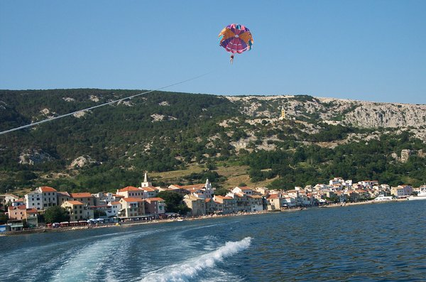 parasailing over town Baska