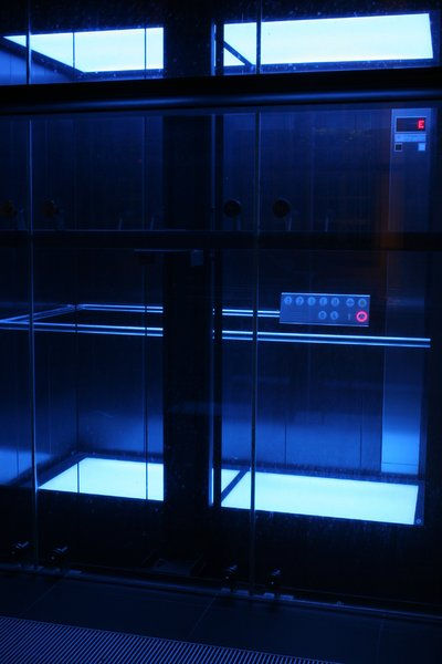 blue elevator: A blue elevator in an office building