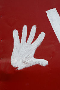 Red left hand: Hand print on a second hand shop's sign. Karoo, South Africa.NB: Credit to read
