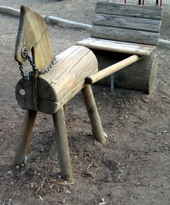 wooden pony on a playground: wooden pony on a playground