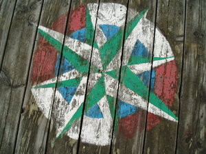 Compass rose: Compass rose painted on an old bridge, now demolished.
