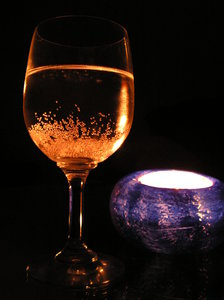 Glass & Candle: Shadow, wine, and silence