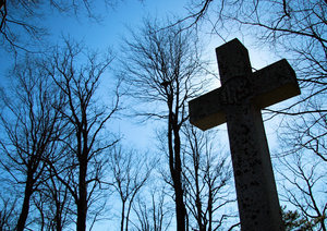 Lift High the Cross: Cross in a cemetary in Wolfville, Nova Scotia, Canada behind an Anglican Church