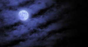 Blue Moon: I took this shot last fall, the exposure was long so even the slow moving clouds looked active, the moon stayed in the right spot though. :-)