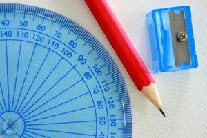 Geometry: Plastic protractor with a pencil and sharpener