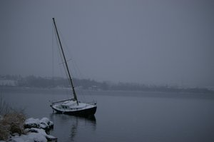 Don't forget me: Sailboat in wintertime, waiting to be taken ashore
