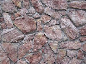 Stone wall: A wall made of stones. Modern one.