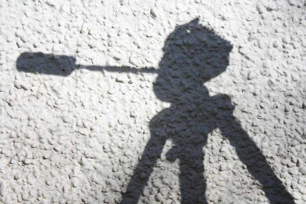 Tripod shadows: Shadow of a camera tripod on a wall