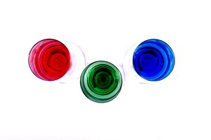 RGB from above: Champagneglasses with red, green and blue juice from above.