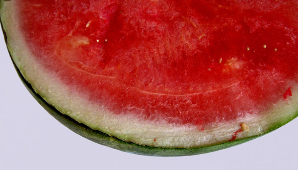 water melon red: cut water melons - green exterior, red interior