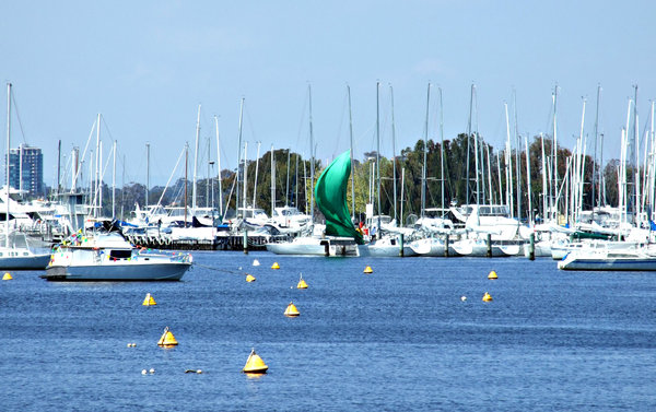 penned in: riverside marina with boat pens and many small yachts at anchor