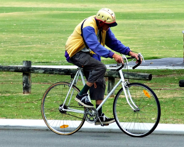 senior cyclist: senior citizen riding his bicycle