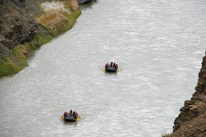 Rafting in the Himalayas: The relatively calm stretch of the River Zanskar, the silence can be like meditation, tall mountains on either sides.