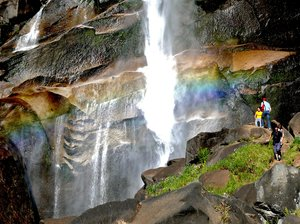 Vernal Falls Mist Trail: The world famous Vernal Falls mist trail day hike out of Yosemite Valley and behind Half Dome. A rainbow graces the view whenever the sun is shining adding a wonderful array of colors to the dense foliage in the mist.