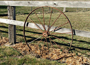rusty hard wheel: old rusty hard wagon wheel