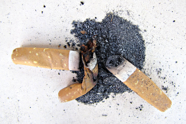 no butts: cigarette butts in small heap of ash