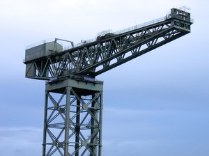 large crane: large crane at the bank of the river clyde in Glasgow, Scotland,it is called the Finnieston Crane, see