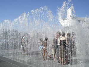 Fun fountains: Youngsters enjoying a fun fountain installation in London, England, on a hot summer day.