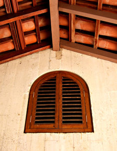 arches & angles: interior roof structure and arched wooden window shutters
