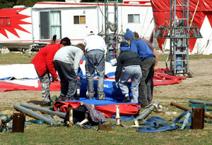 it's the circus!: circus workers preparing to erect the big top