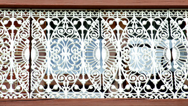 fancy protection: balcony safety railing in delicate and artistic wrought iron in an Australian style known as Paddington lace