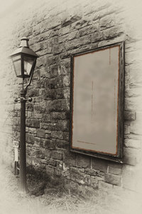 Old sign with gas lamp: Old style photograph with a gaslamp and advertising board for your own content.