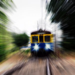 Fast train: Zooming effect and city train in Poland