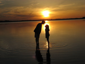 Kiss in the sunset: My two children playing