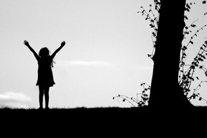 Girl Silhouette: Silhouette of happy young girl