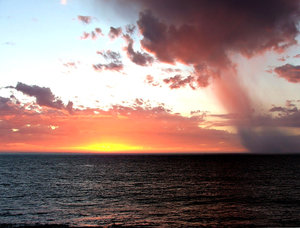 storm clouds at sunset: evening sunset storm clouds over ocean