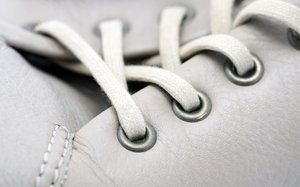 Shoe macro shot: Close up of white leather shoe