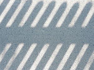Shadows: Shadow of a fence on the pavement