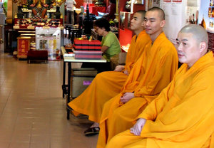 monks in waiting: group of monks waiting, available for consultations and prayers