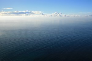 Distant horizon: Panoramic view of the Atlantic Ocean from a high cliff on the southern coast of Madeira.