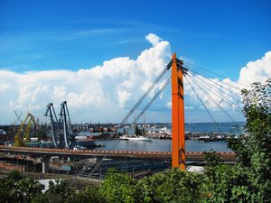 Odessa sky 1: bright blue sky and clouds over Odessa port with cranes
