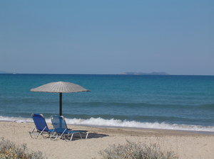 Beach idyll: Lonely beach in Acharavi - Corfu with deck chairs and sun shade