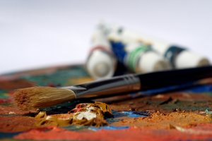 Brush and paint: The artists brush and paint on a palette.