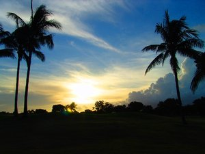 Golfing at Twilight: Golfing at twilight in Florida with a storm coming in from the North West