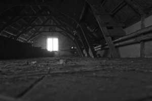 Dark attic: An abandoned house has a dark attic.