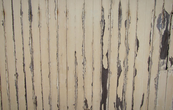 lines of peeling paint: wall of old wooden railway carriage