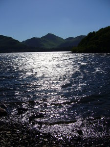 Derwentwater, Lake District 2: A tranquil view of Derwentwater, near Keswick in the Lake District, photographed down by the shore in the early evening.