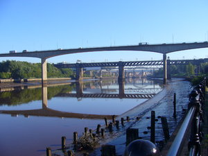 Bridges of the Tyne 1: A series of views showing the bridges over the River Tyne that link Newcastle and Gateshead.Taken from the riverside walkway between Gateshead Quays and Staiths South Bank, this view shows the Redheugh Bridge in the foreground with the King Edward Bridge