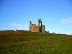 Dunstanburgh Castle 2: Located on the Northumberland coast, Dunstanburgh Castle was a Lancastrian stronghold during the Wars of the Roses (1455 - 1485). Heavy cannon damage left the castle in ruins, the condition in which it remains today. It's now owned by the National Trust a