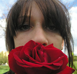 Girl with Rose: a teenage holds a rose
