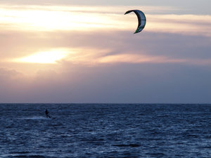 Kite surfer in backlight