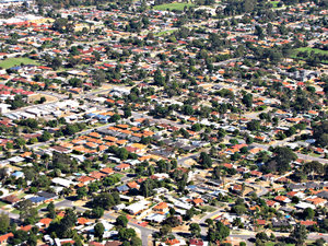down in the suburbs: looking down on Australian suburbs through airplane window