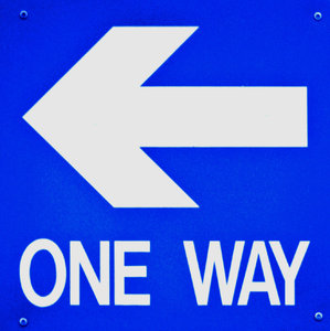 the way back: bright blue one way sign pointing back
