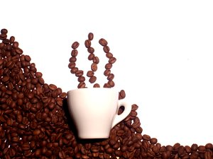 Hot coffee: Coffee beans as smoke from a cup of coffee